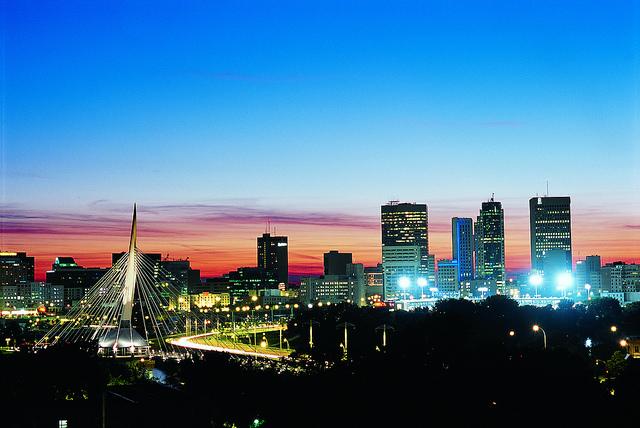 Winnipeg skyline at night (shared under Creative Commons license from: http://www.flickr.com/photos/travelmanitoba/)